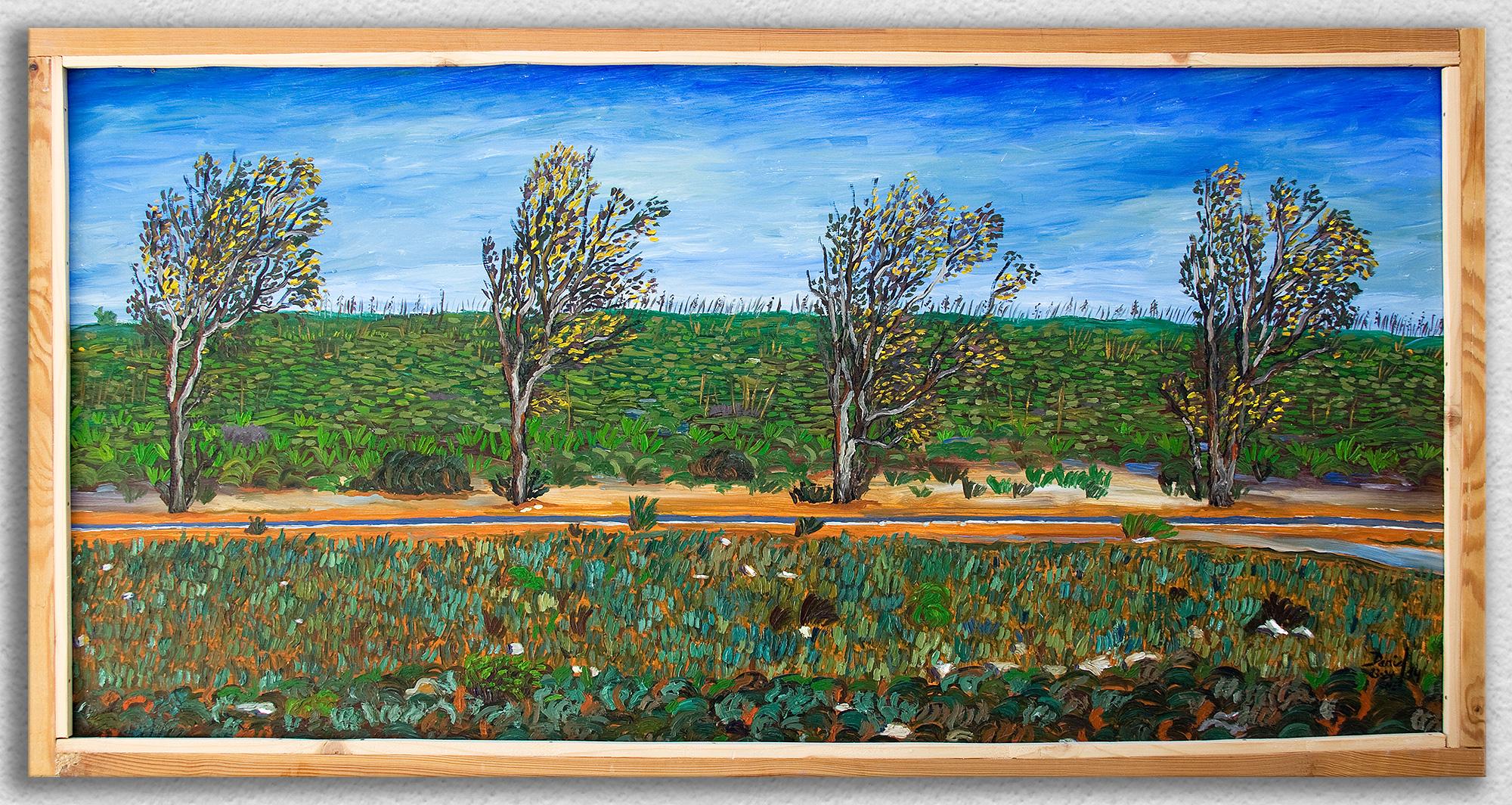 Cuatro eucaliptos con carretera