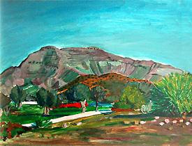 Camino con olivos y montaña